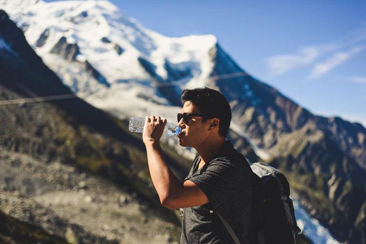 Hiking man drinking water